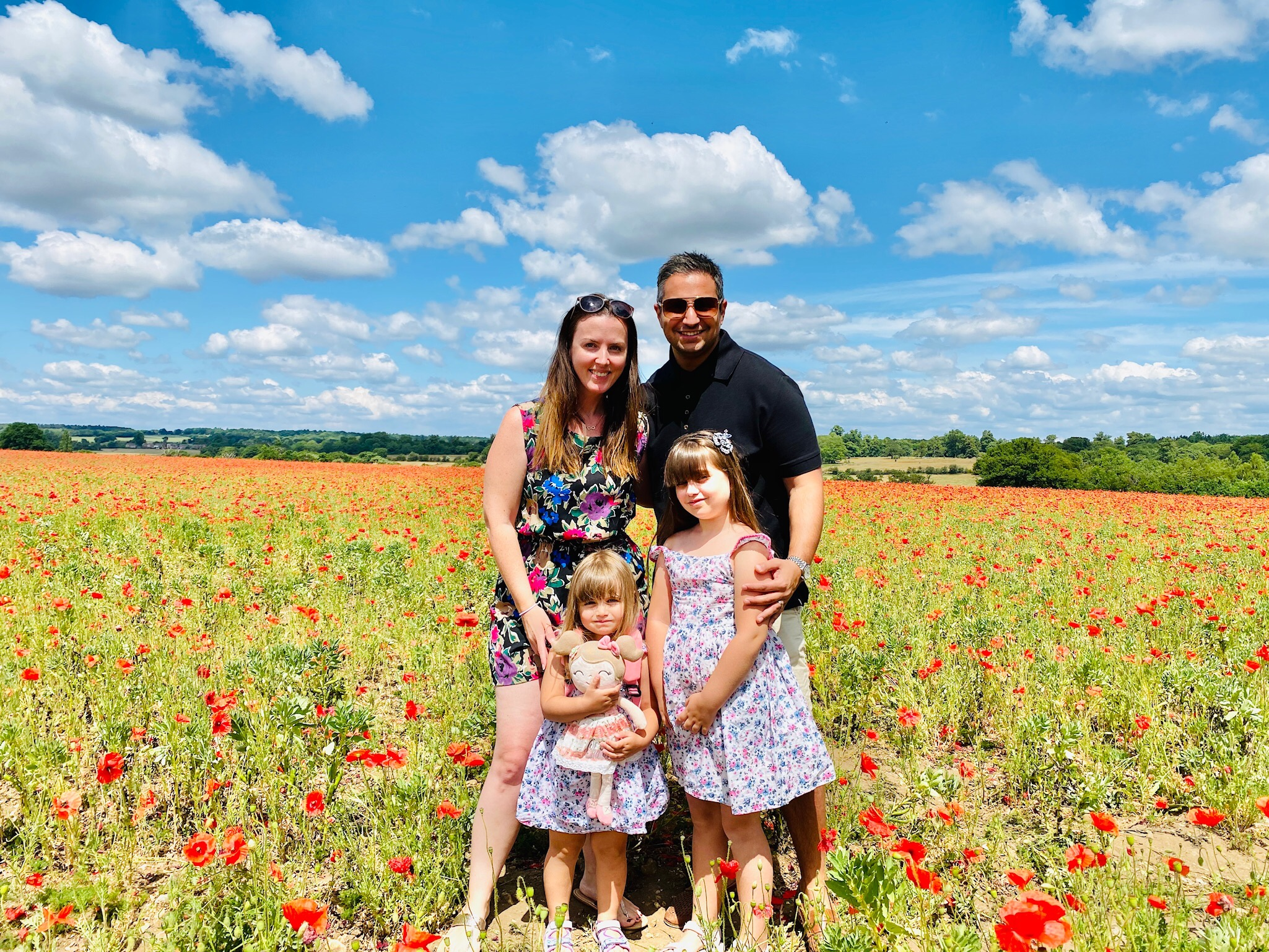 family standing in poppy field in Hertfordshire